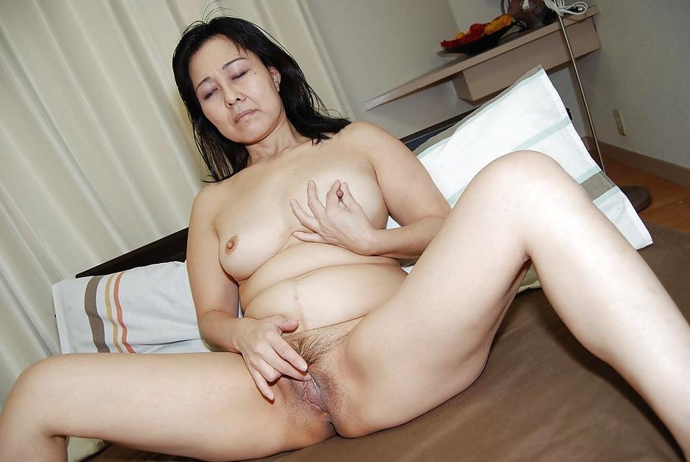 Old asian milf masturbating