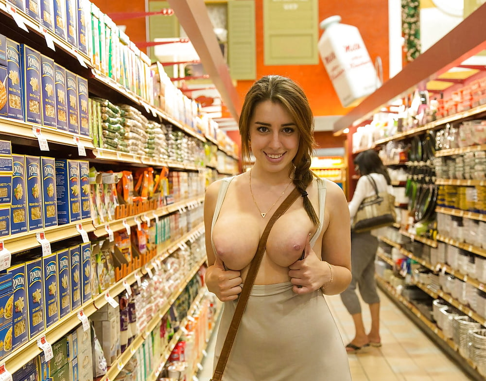 Photo of asian flashing big tits in super market