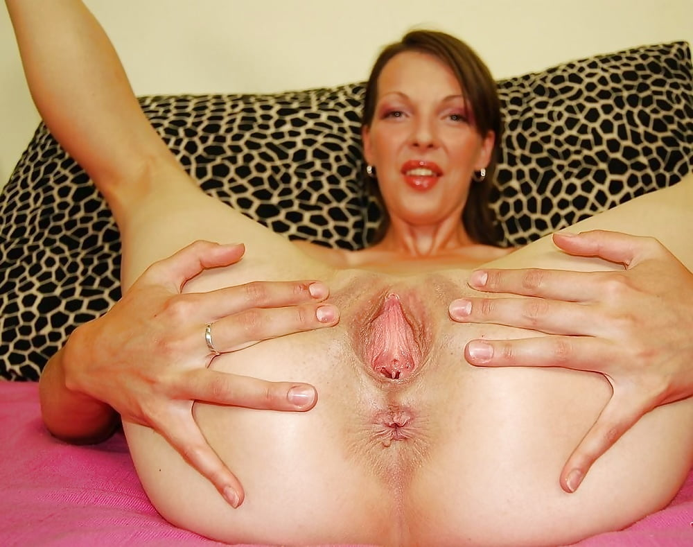 Smooth mature pussy spread