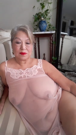 Mature bbw woman in a transparent night gown