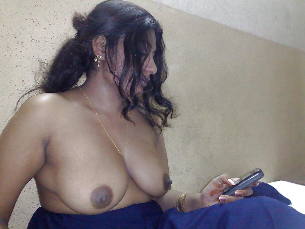 Indian aunty self shot nude pics inside bathroom