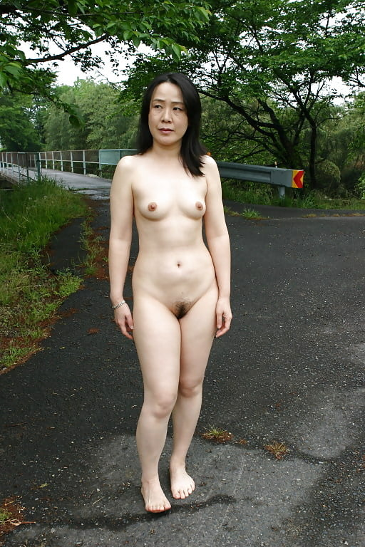 Outdoor asian nude seated