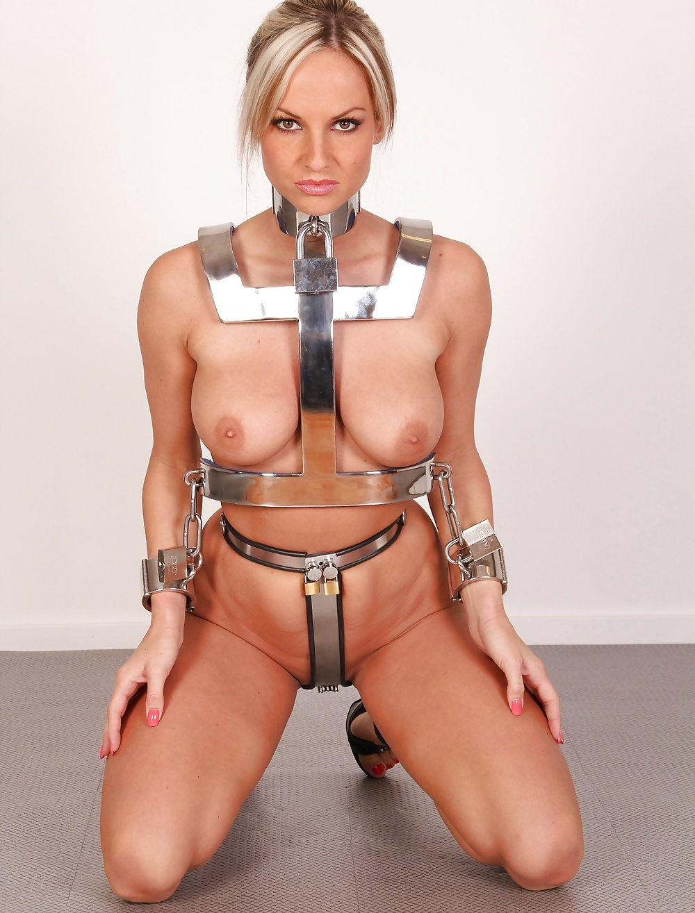 Hot blonde in leather harness training day
