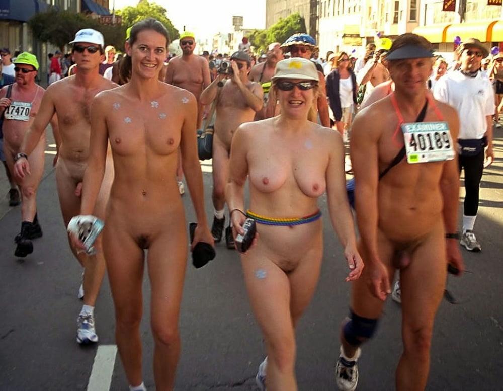 Hundreds of naked runners strip off for denmark's annual roskilde festival naked race