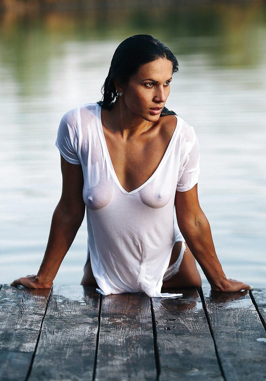Sexy woman beach wet tshirt stock photo
