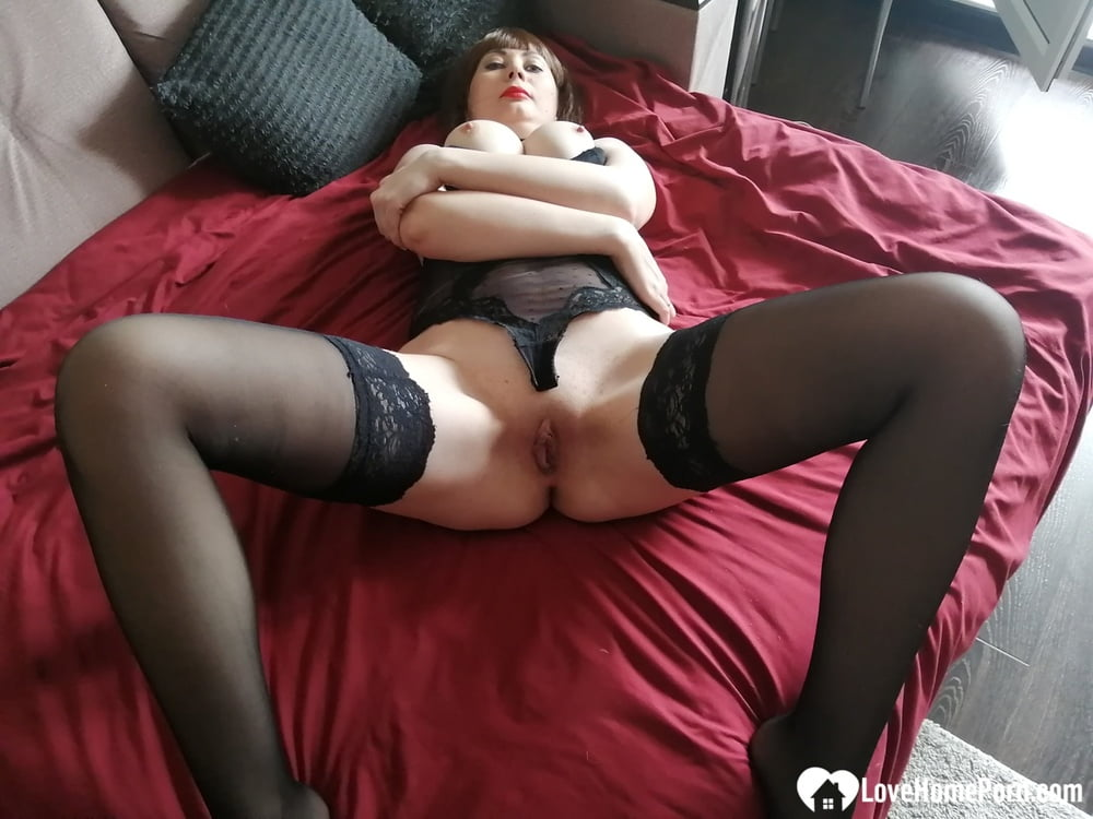 Mommy in stockings loves to finger herself