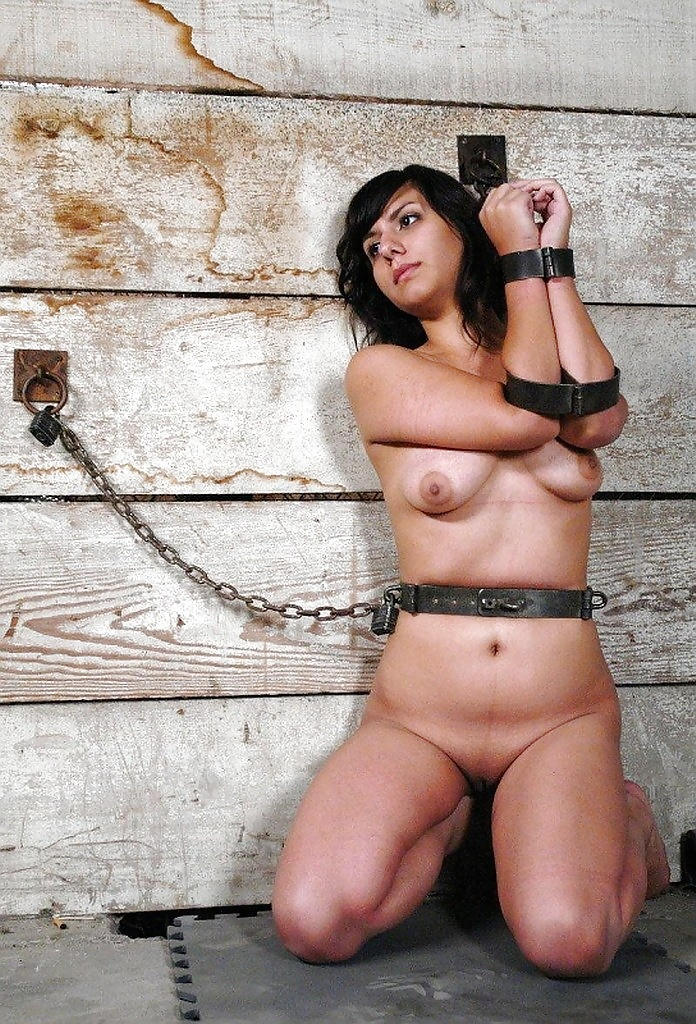 Athletic nude brunette bound rope stock photo