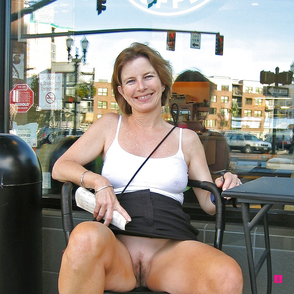 Mature wife flashing pussy in public