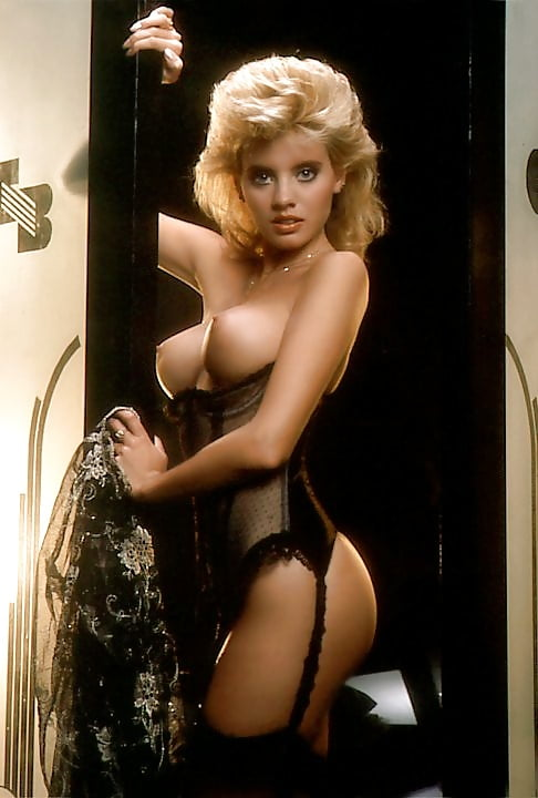 Luscious vintage blondie showing her fine tits with joy