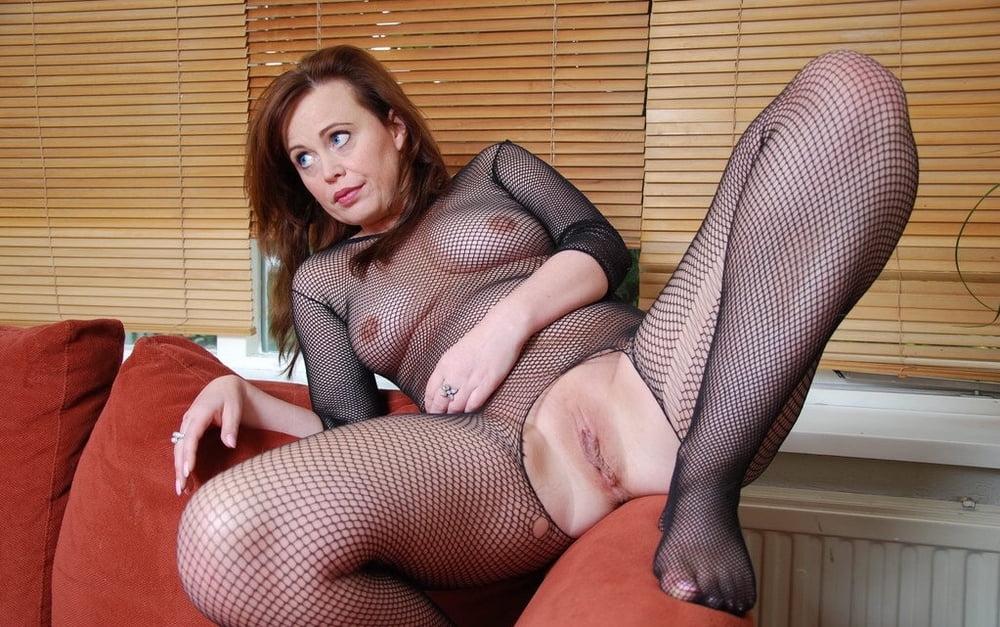 Amateur spreads dildo masturbation bodystocking