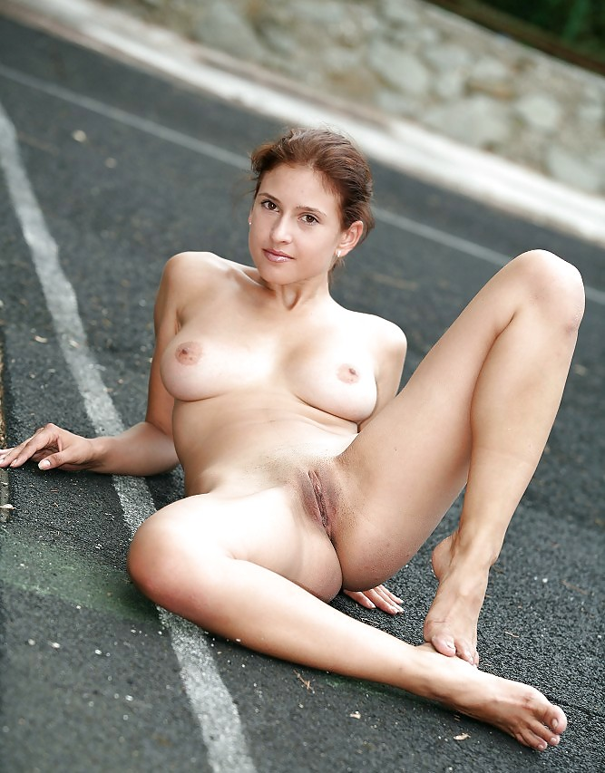 Ridiculously good looking chick showing her pussy by crouching next to road