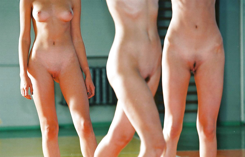 Naked beach volleyball players