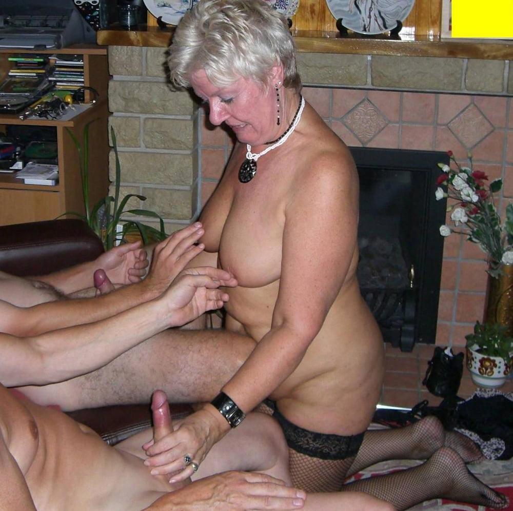 Mature giving handjob