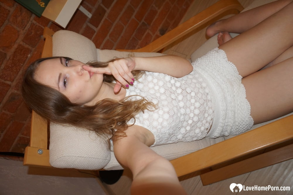 Smoking teen posing in a sexy schoolgirl outfit - 14 Pics
