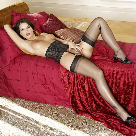 brunette sexbomb in red dress and stockings