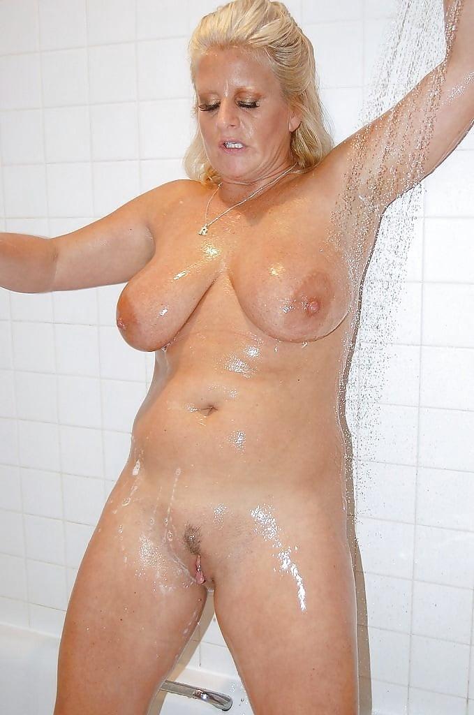 Mature man in shower stock photo