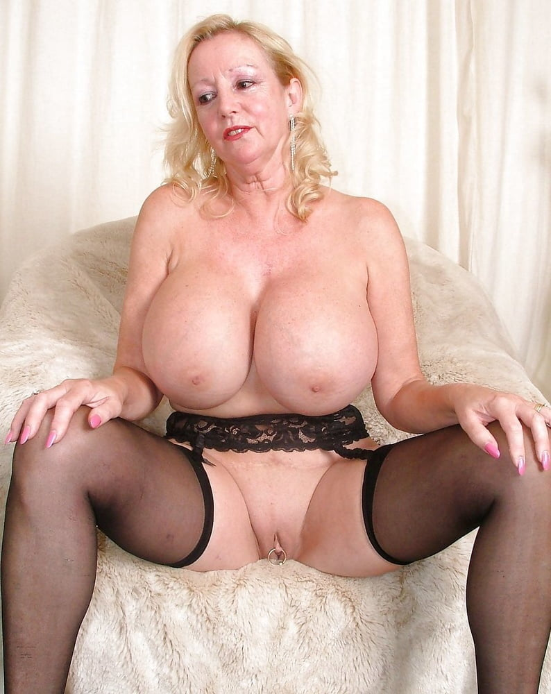 A Granny With Large Tits Is Doing A Hot Blow Job Close To The Camera