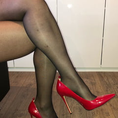 Hot Sexy Bitch In Black Panthyhose And Red High Heels