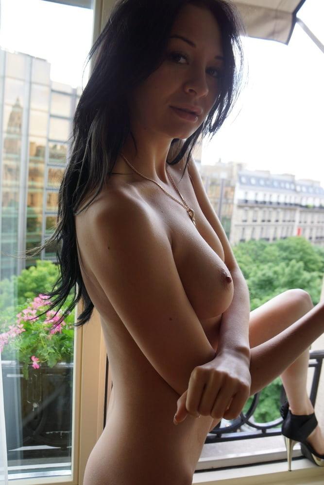 Skinny brunette posing on vacation in a European resort - 88 Pics