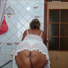 Lukerya In White Transparent Linen In The Kitchen
