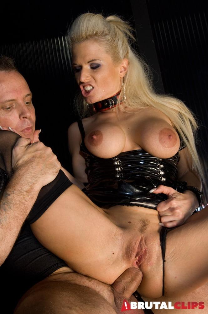 Dominatrix Jamie Brooks In BDSM Action - 27 Pics