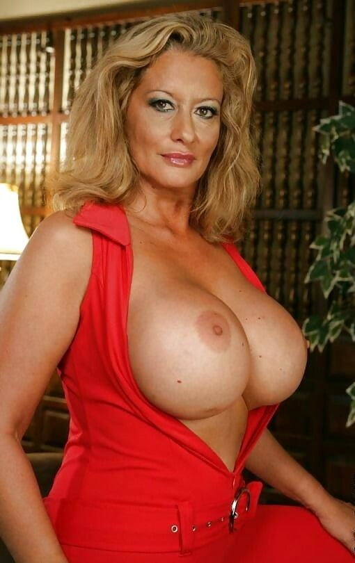 Mature busty british lady shows off her chest meat and sucks those big milky tits