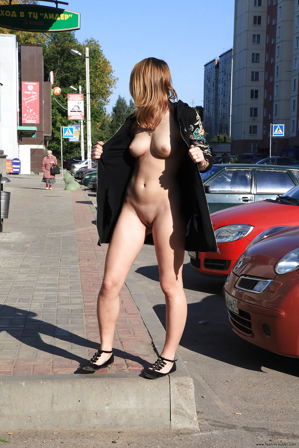 Very hot young brunette chick flashing her pretty pussy on a busy street