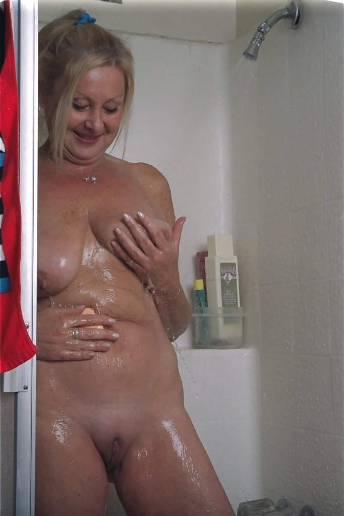 Granny standing naked in shower 13