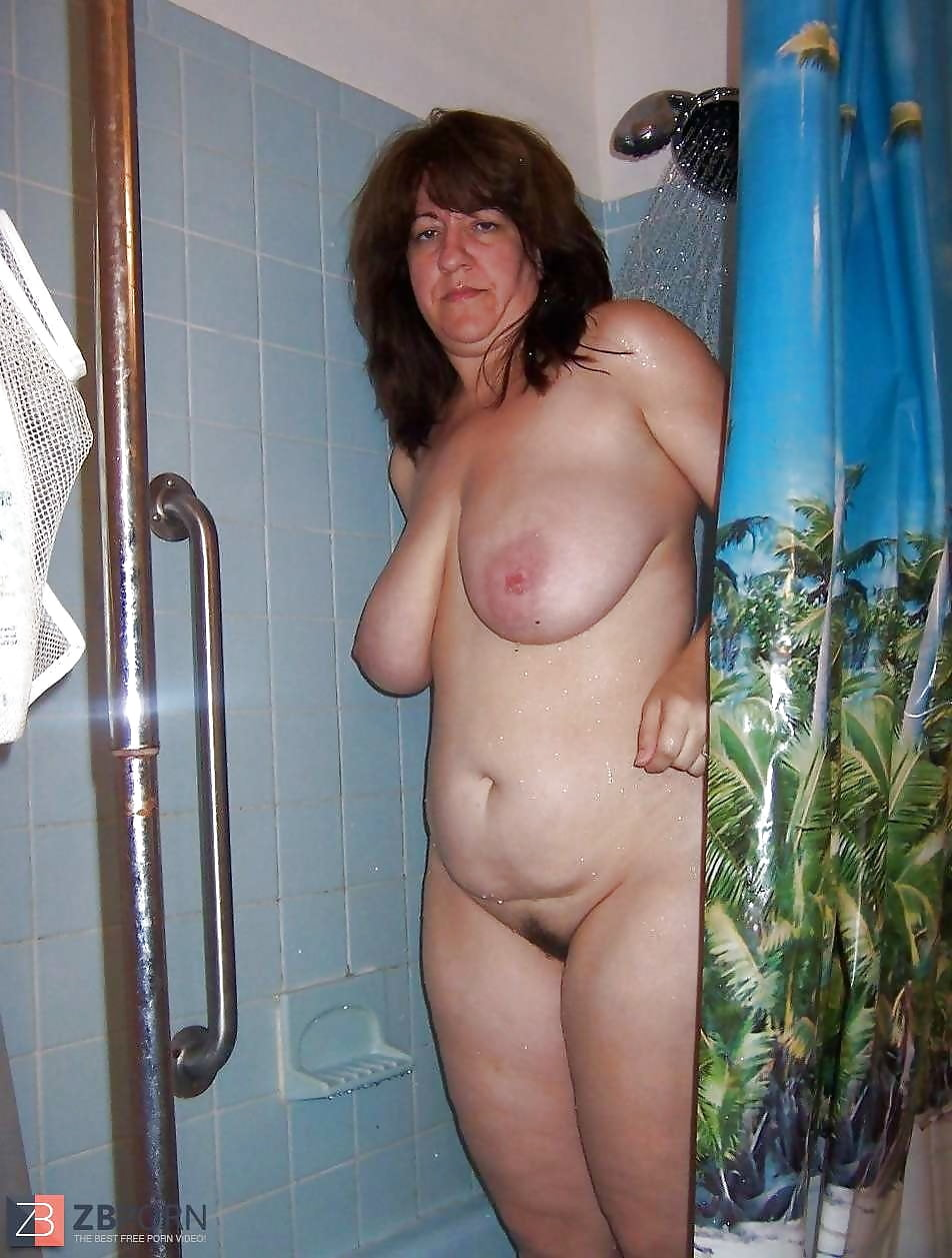 Older blond playing in the shower
