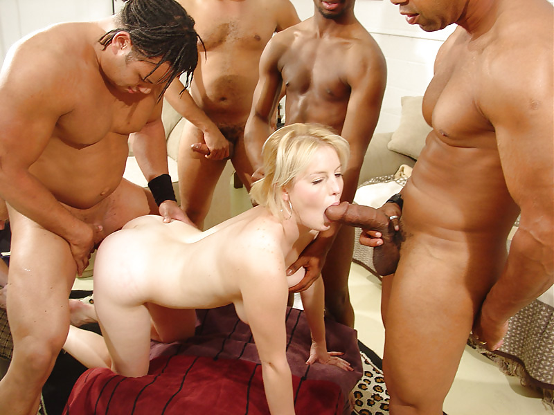Sexy woman is getting fucked hard by three dudes in a gangbang