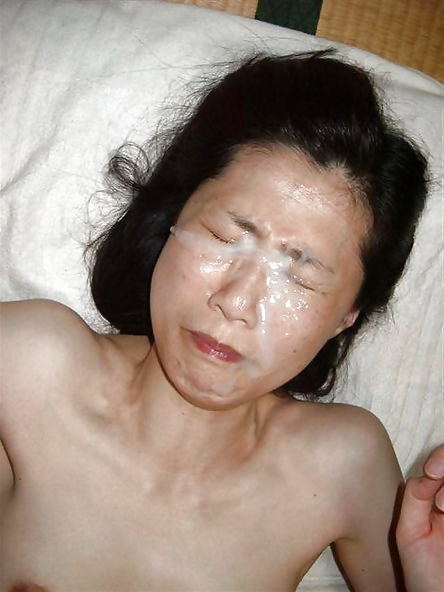 Mature asian takes a load on her tits