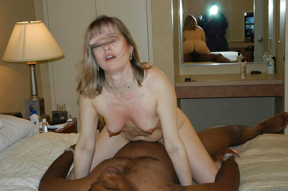 Mature Man And His Pregnant Mature Wife Sitting On Bed Touching Her Belly High
