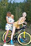 Two blonde teen with bicycle by Sail