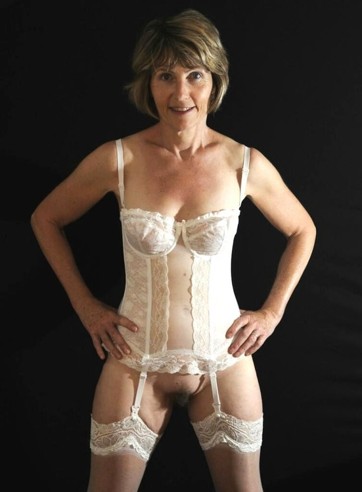 Hot mature secretary in sexy lingerie flashes hairy vagina