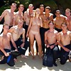 Only nude girl with bunch of clothed men