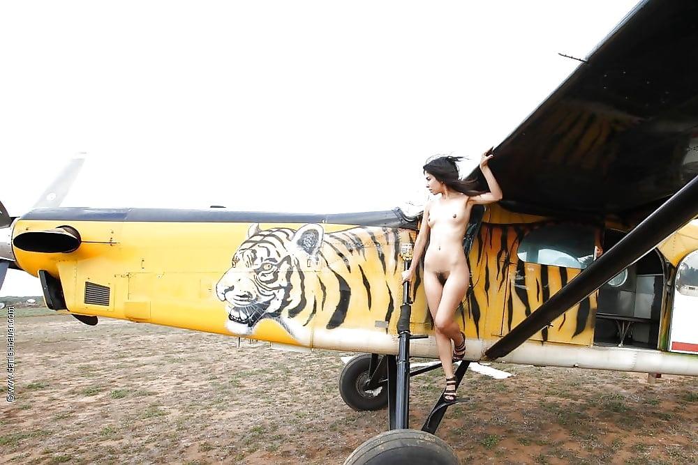 Sexy girl having sex on plane pics