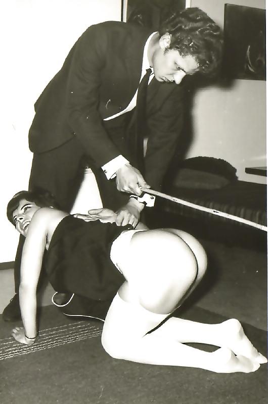 Vintage photo man being spanked stock photo