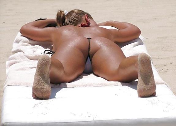 Girl with string bikini up butt