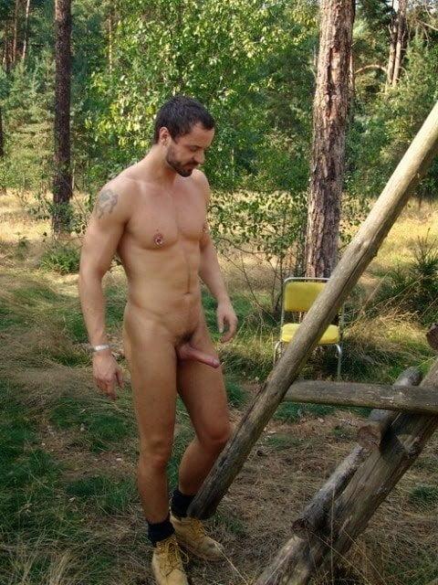 Naked screaming man with iron stock photo
