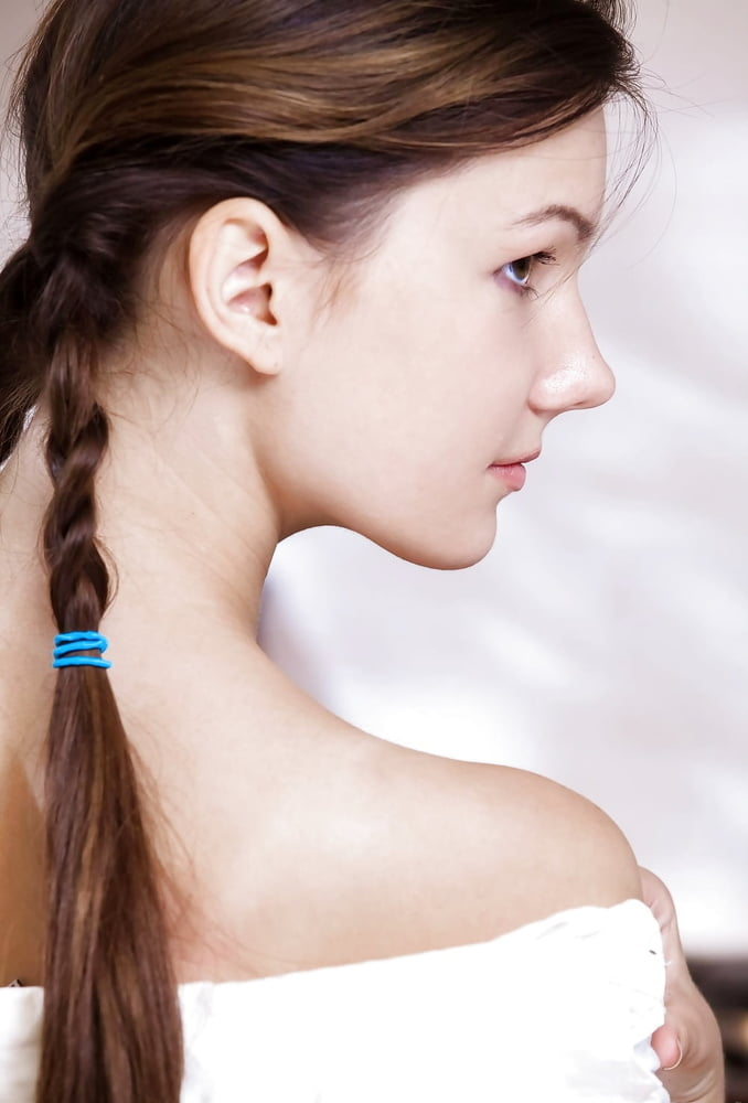 Little girl braids to the side with beads-1435