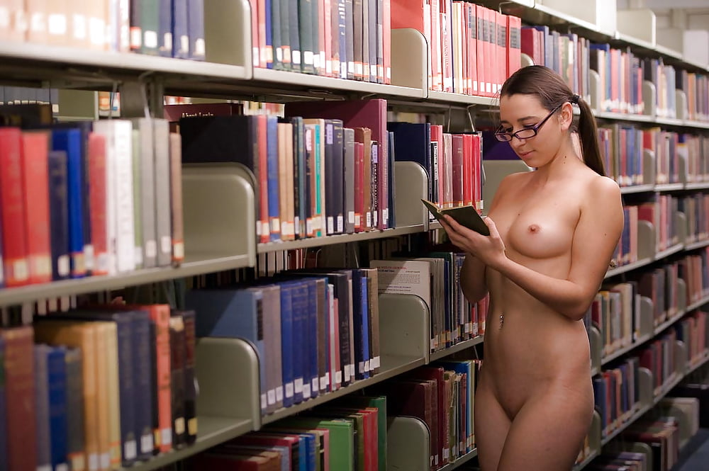 Blonde librarian in lace stockings masturbates