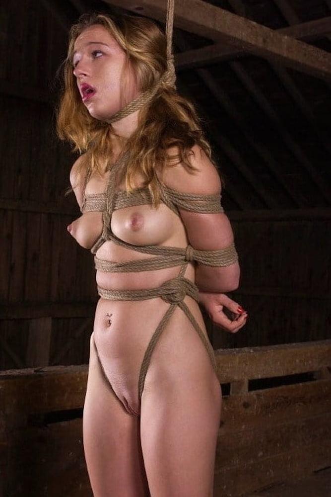 Wench in bondage sucks on cock
