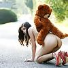 Girl Nika  playing with her teddy bear