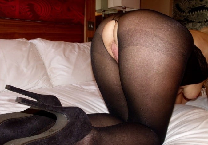 Sexy matures in black crotchless pantyhose