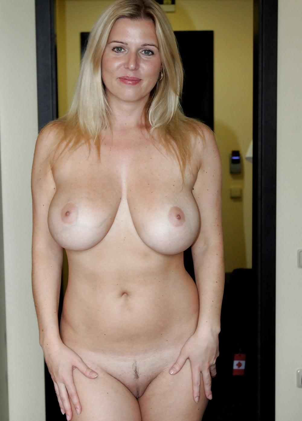 Amateur milf wine glasses naked nude shaved legup smile smiling happy bathroom blonde