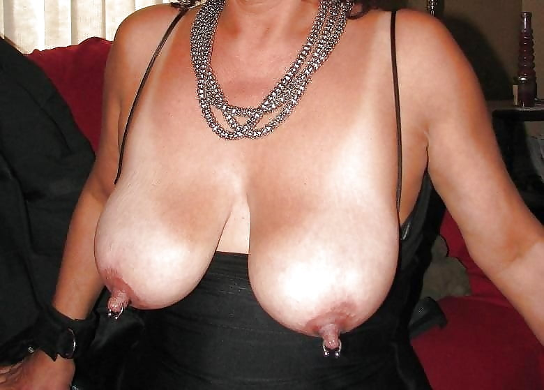 Blonde mature lady wifey showing her tits with pierced nipples