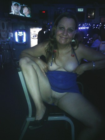 Flashing her pussy at the bar