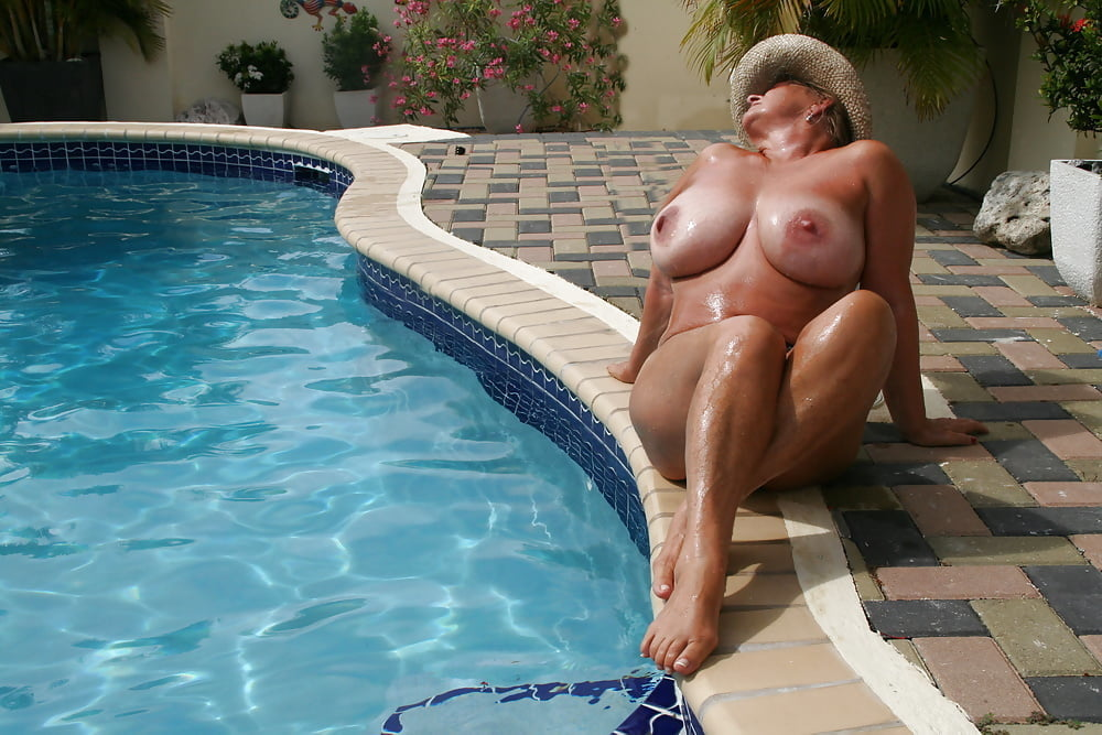 Three grannies going nude together by the pool