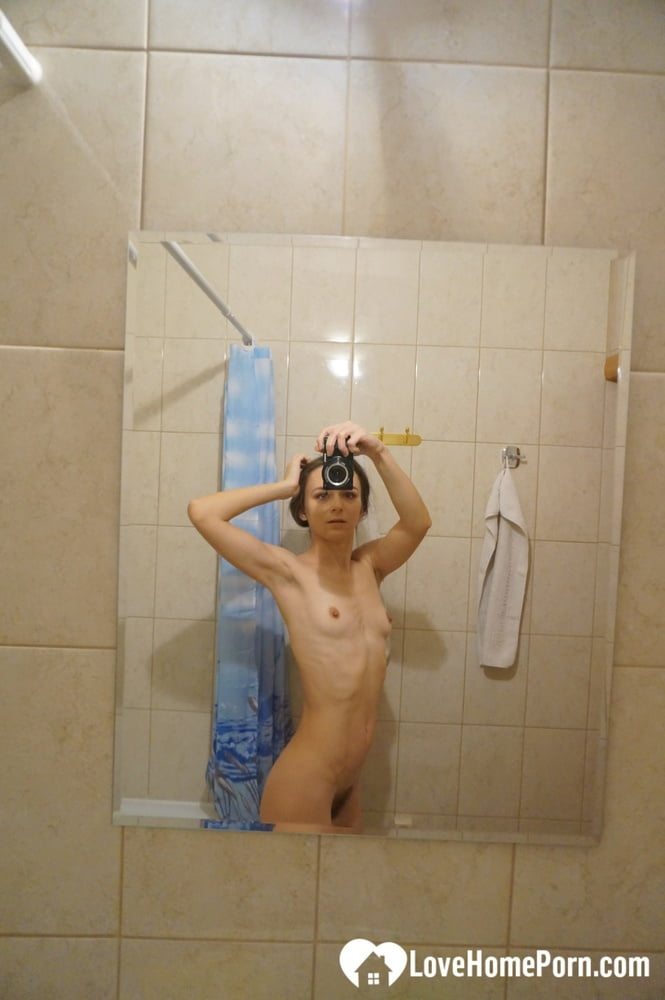 Skinny beauty testing her new camera while naked
