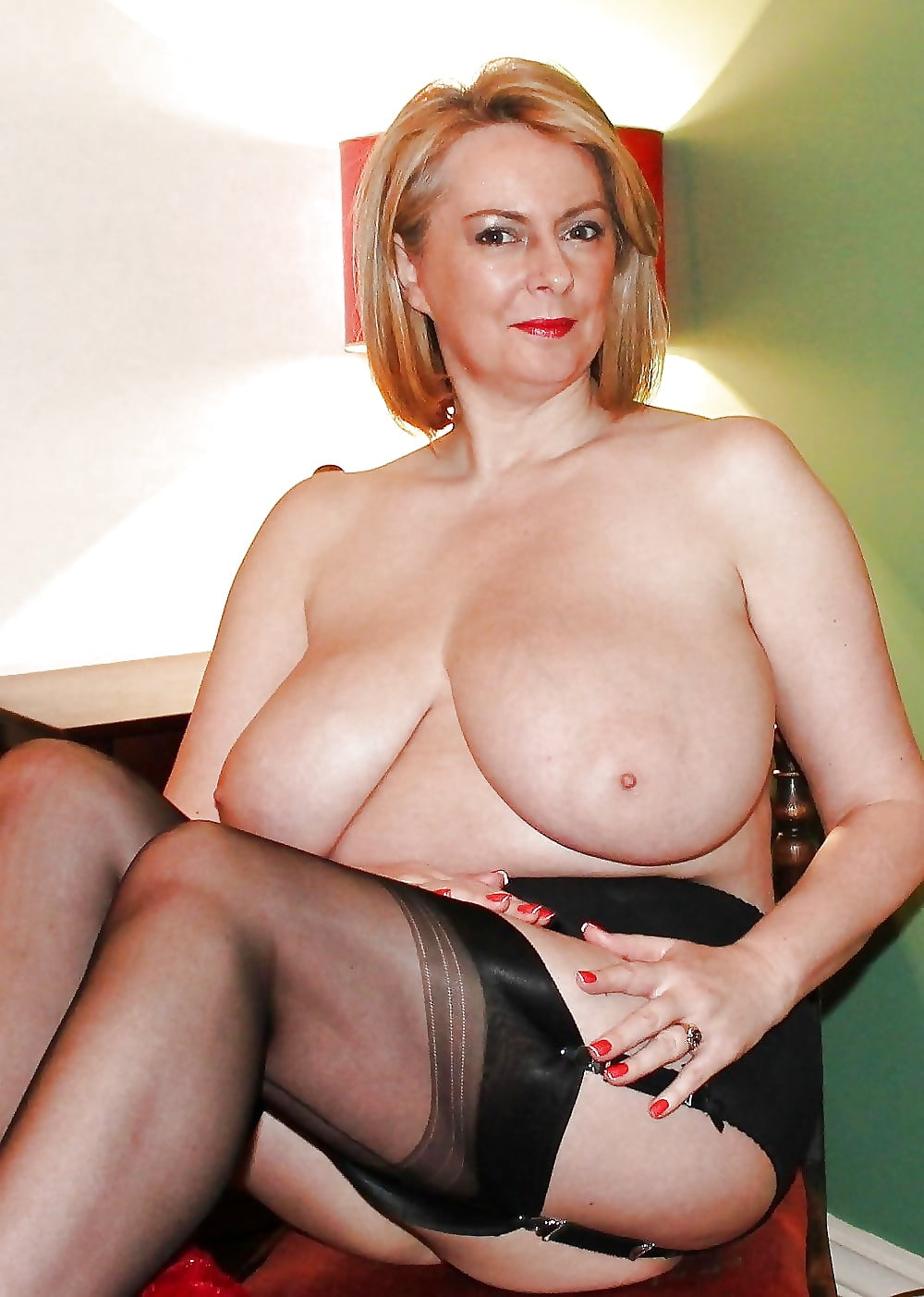 Busty mature woman stock photos and images